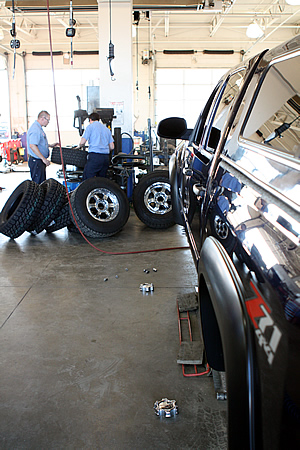 Mounting the LT285-70-17 Cooper ST Maxx tires on our 2011 Chevy Silverado 1500 Crew Cab 4WD at Tire Rama in Spokane WA.